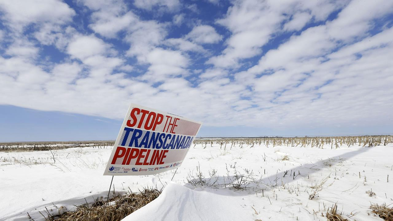 File photo of a sign reading Stop the Transcanada Pipeline stands in a field near Bradshaw, Neb., along the Keystone XL pipeline route through the state (AP Photo)