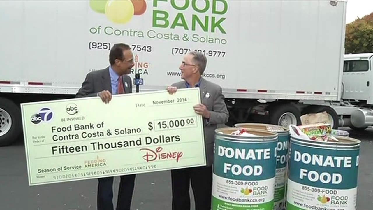 Spencer Christian presents $15,000 check to Food Bank of Contra Costa and Solano.