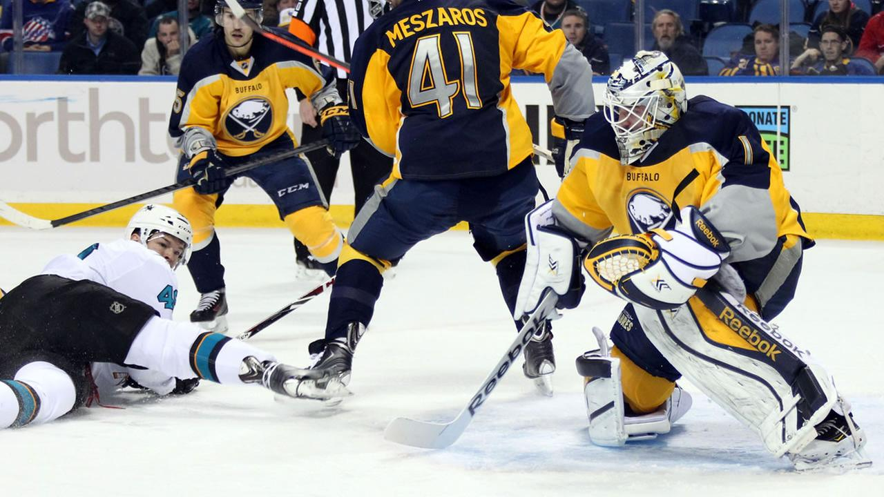Buffalo Sabres Jhonas Enroth (1), of Sweden, and Andrej Meszaros (41), of Slovakia, defend the net against San Jose Sharks Tomas Hertl (48), of the Czech Republic.