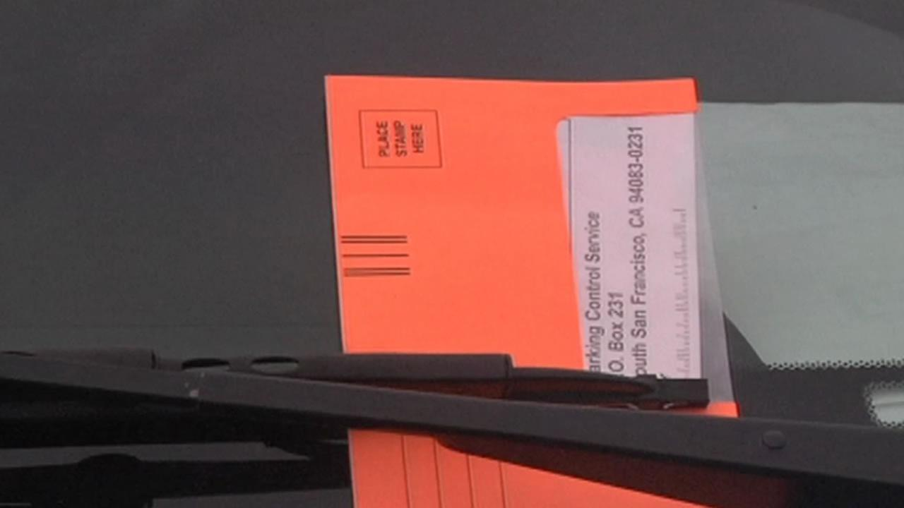 parking ticket with an orange envelope