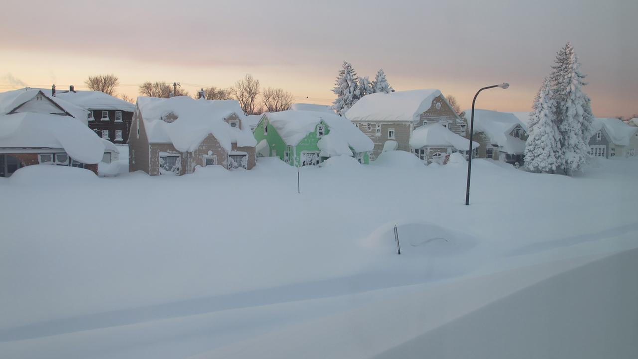 Snow covers a street at daybreak Wednesday, Nov. 19, 2014, in south Buffalo, N.Y. Buffalo-area.