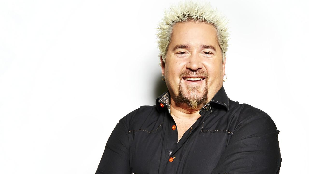 Guy Fieri poses for a portrait, on Monday, Dec. 9, 2013 in New York. (Photo by Dan Hallman/Invision/AP)
