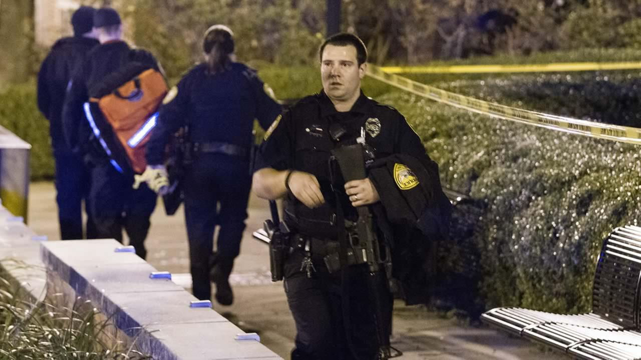 Tallahassee police investigate a shooting outside the Strozier library on the Florida State University campus in Tallahassee, Fla. Thursday Nov 20, 2014. (AP Photo/Mark Wallheiser)