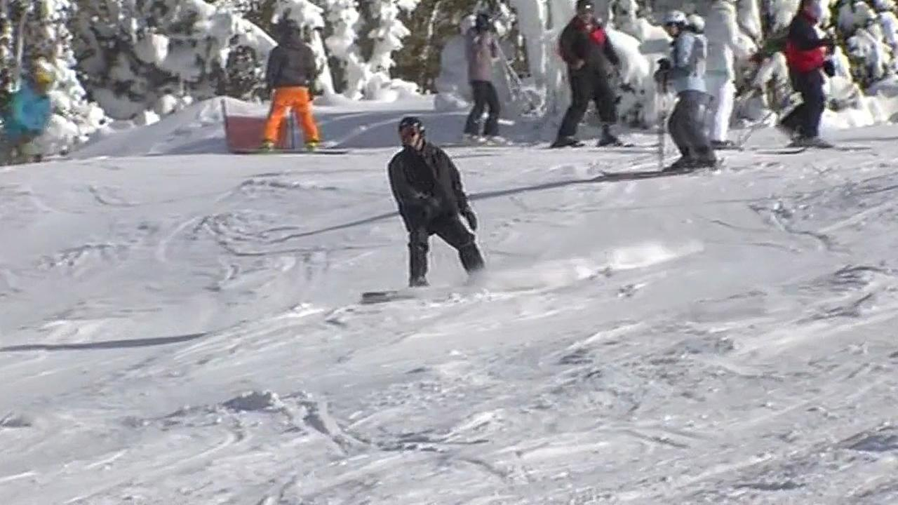 Snowboarder slides down a hill in South Lake Tahoe