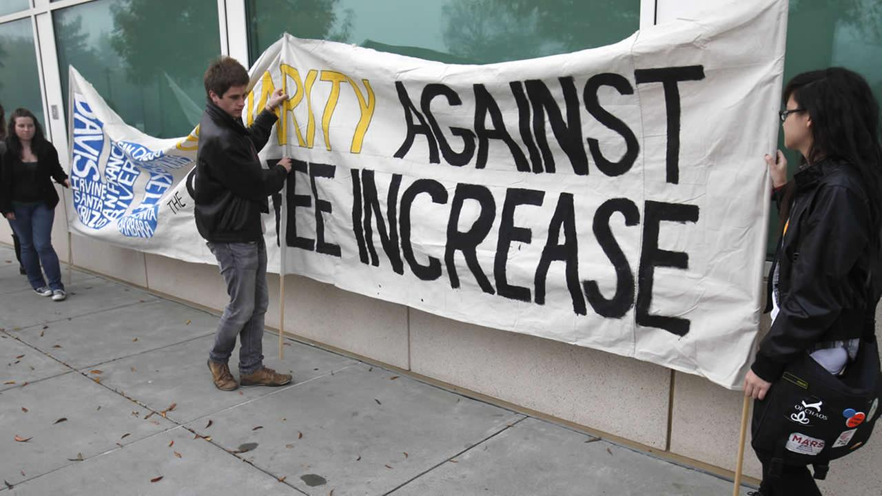 Demonstrators place a sign protesting university fee increases at UC Davis, Monday, Nov. 28, 2011. (AP Photo/Rich Pedroncelli)