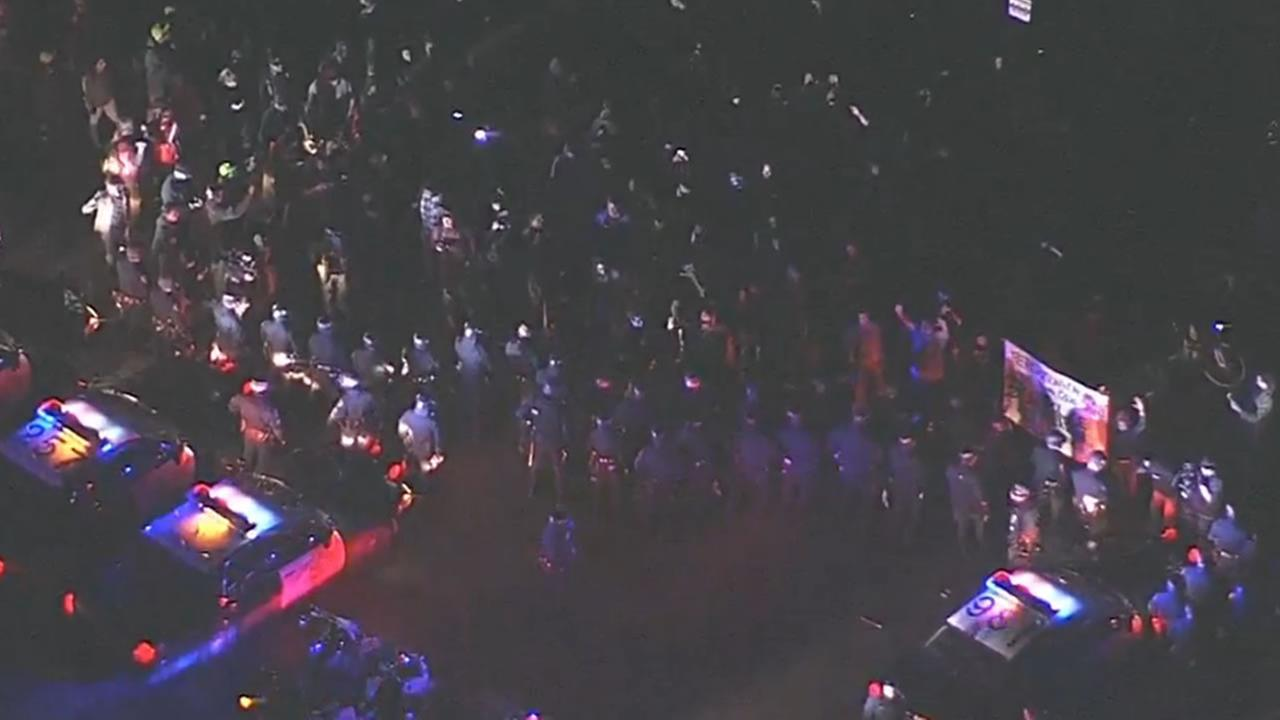 Protesters gather on freeway