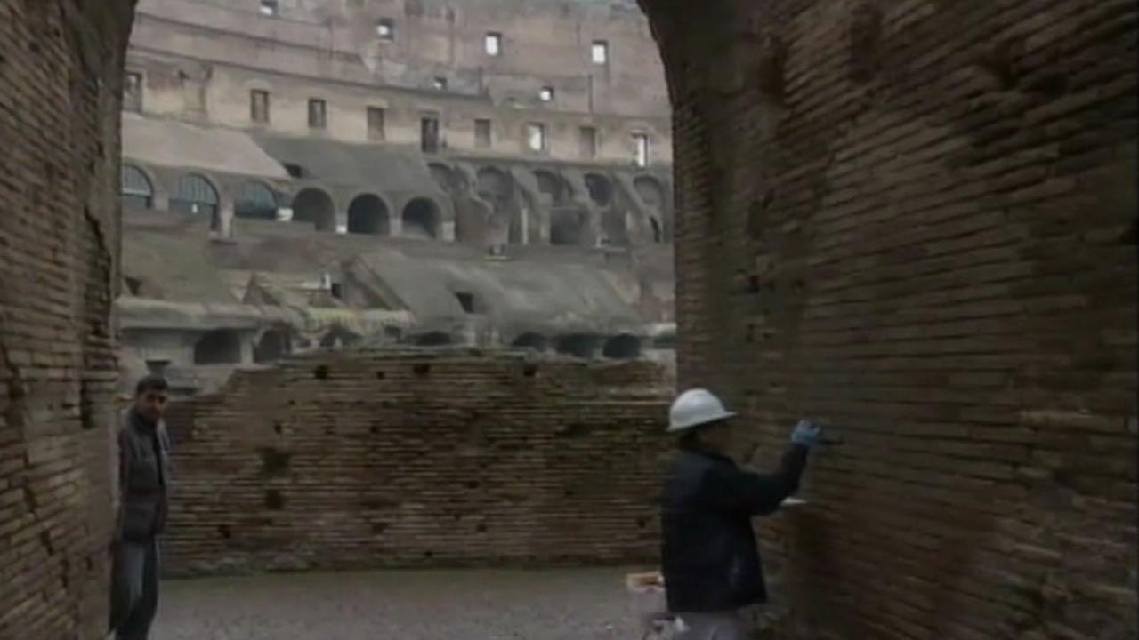 Crews in Rome are working to repair damage caused by a tourist at the Colosseum.