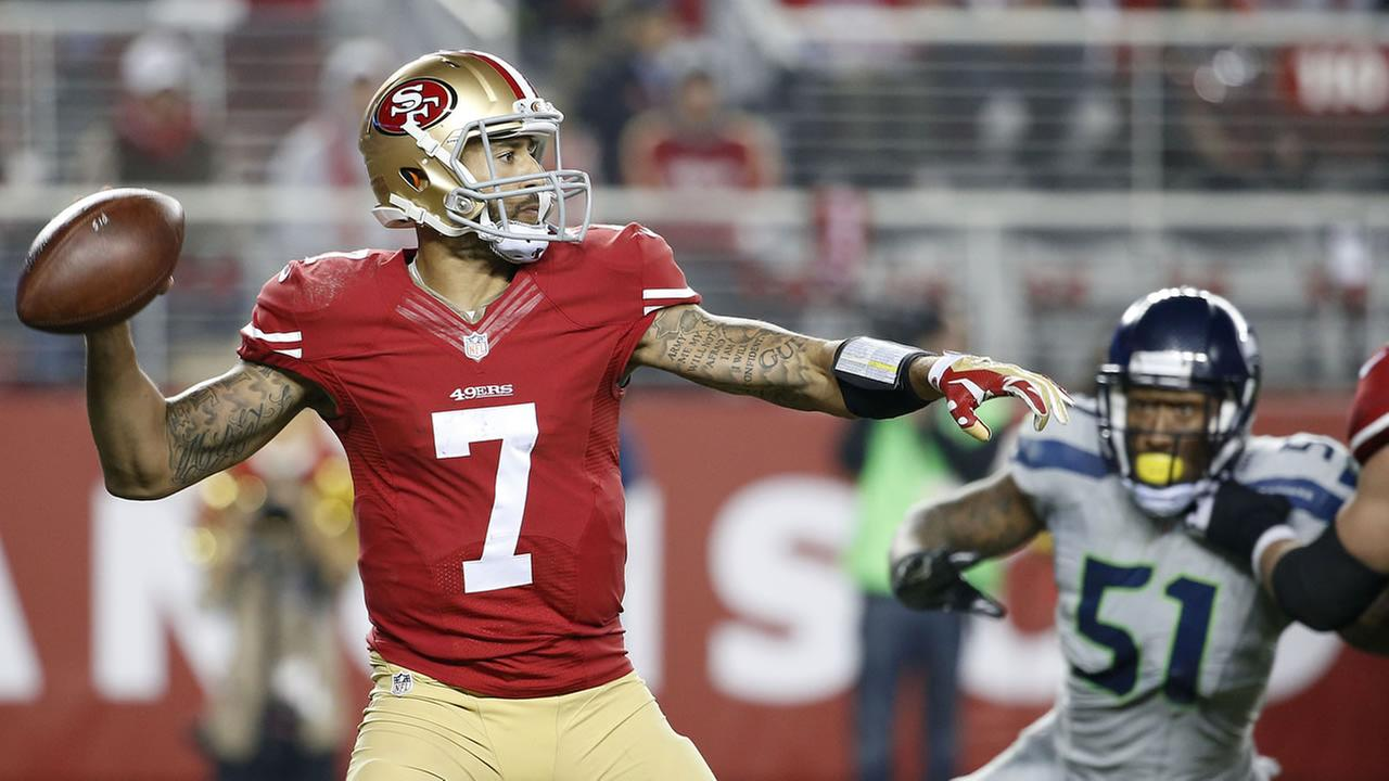 Colin Kaepernick throwing a pass