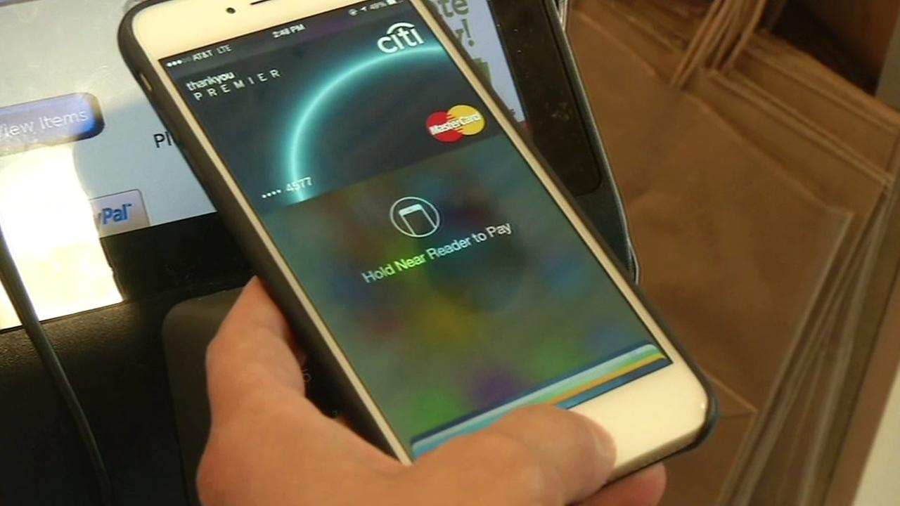 Shopper uses mobile payment app.