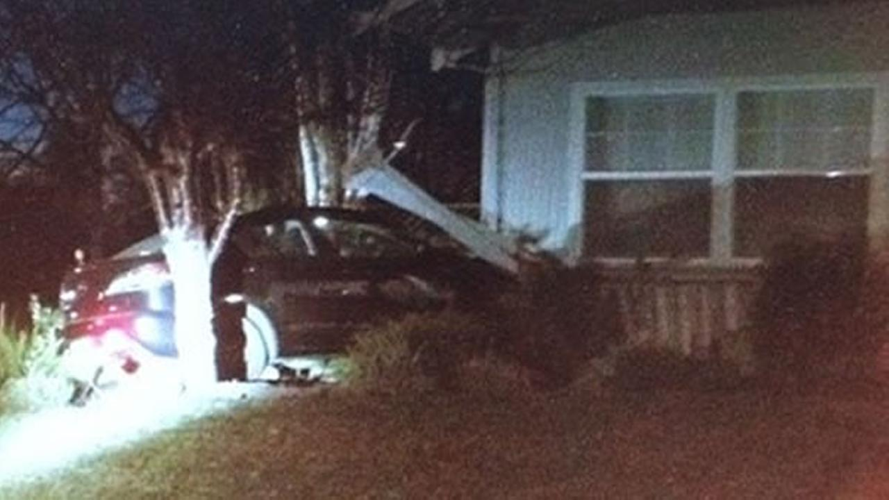 A high school student crashed her car into a house while trying to escape her assassin.