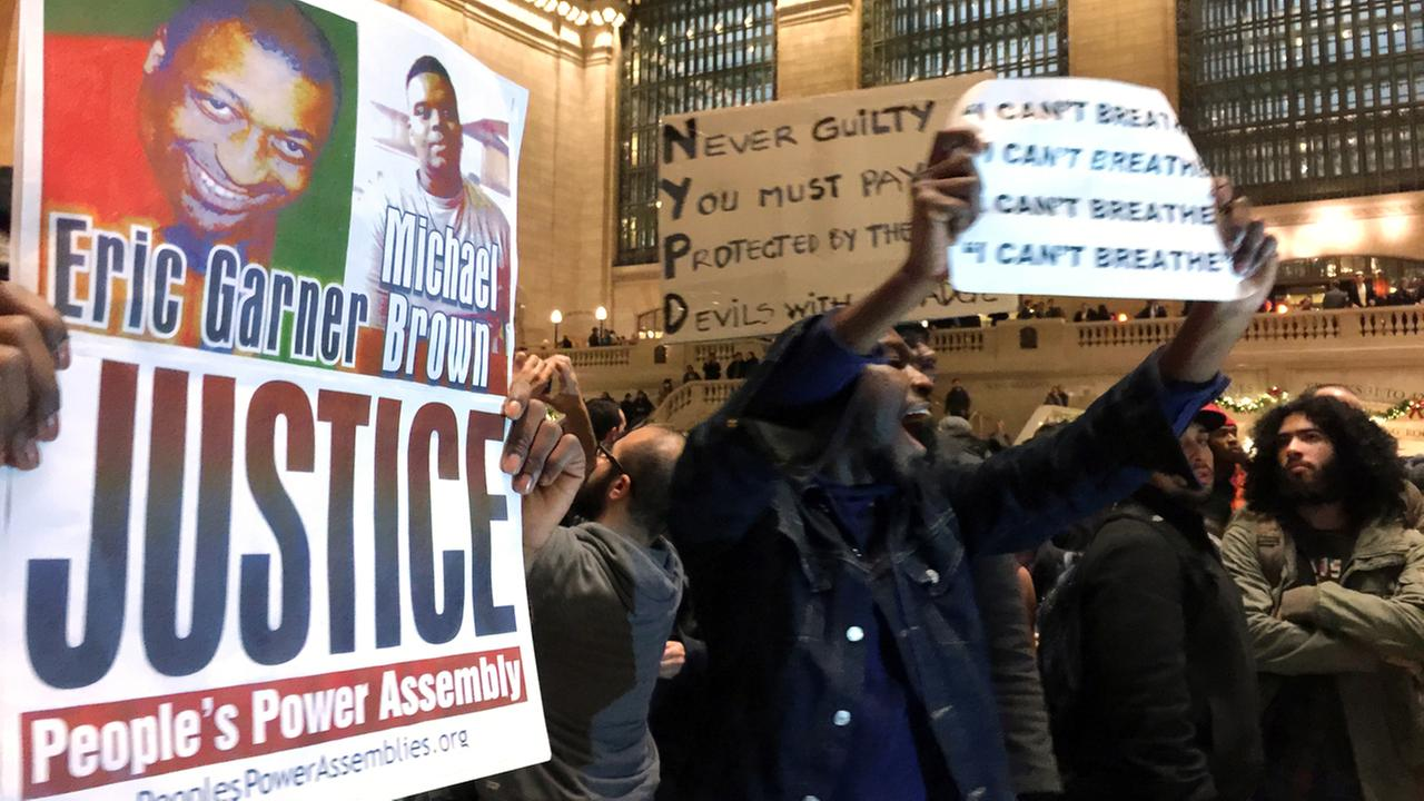 People protest in Grand Central Terminal after it was announced that the NYC police officer involved in the death of Eric Garner was not indicted, Wednesday, Dec. 3, 2014.