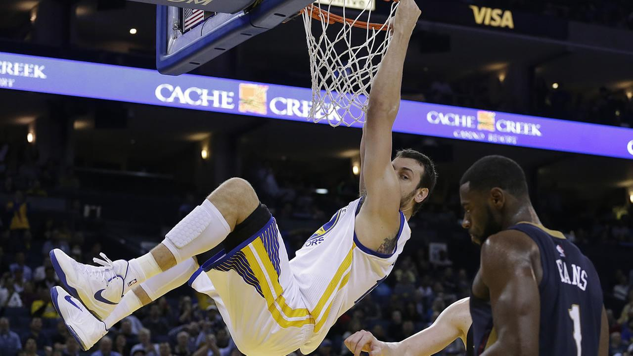 Golden State Warriors Andrew Bogut hangs on the rim
