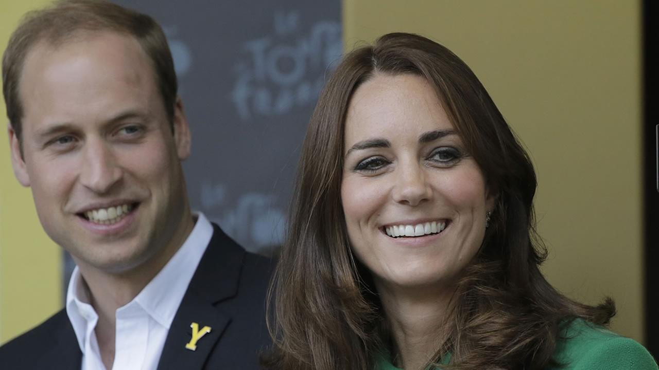 Prince William and Duchess of Cambridge Kate watch the podium ceremony of the first stage of the Tour de France cycling race in Harrogate, England, July 5, 2014.  (AP Photo/Laurent Cipriani)