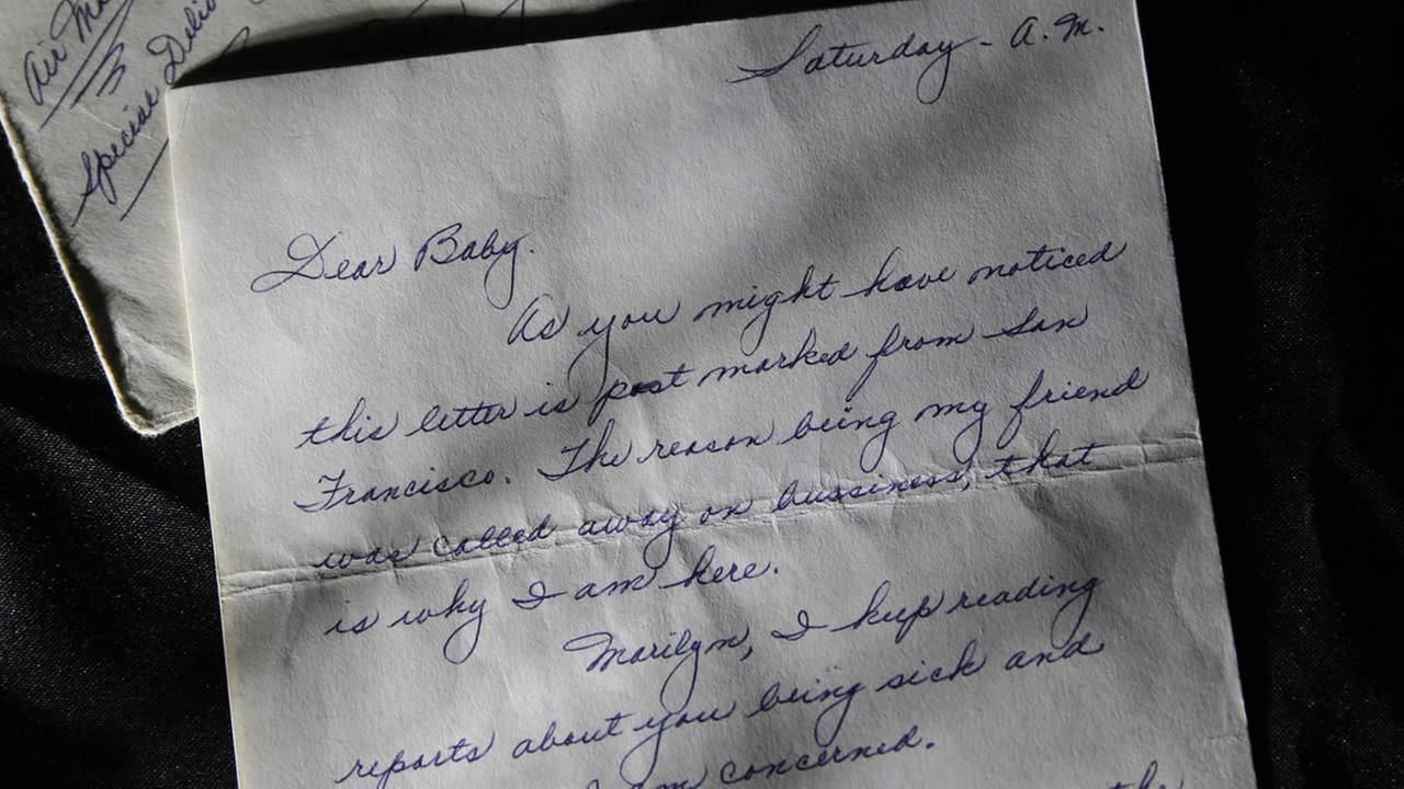 This photo shows part of a three-page handwritten letter and original envelope postmarked Oct. 9, 1954 from baseball legend Joe DiMaggio to Marilyn Monroe. (AP Photo/Jae C. Hong)