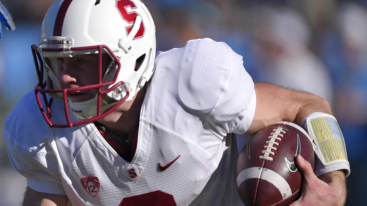 Stanford quarterback Kevin Hogan runs the ball against UCLA on Friday, Nov. 28, 2014, in Pasadena, Calif. (AP Photo/Mark J. Terrill)