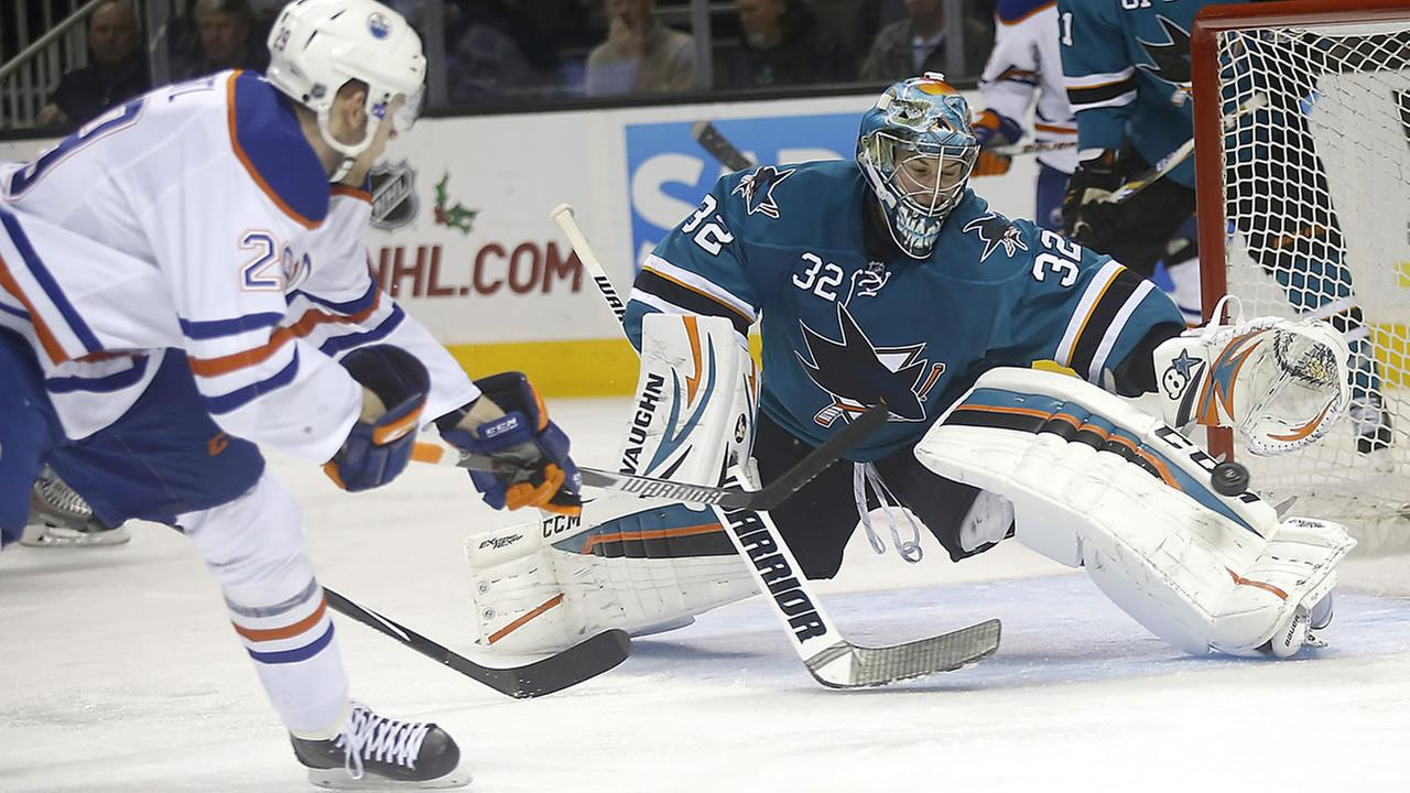 San Jose Sharks goalie Alex Stalock (32) blocks a goal attempt by Edmonton Oilers center Leon Draisaitl