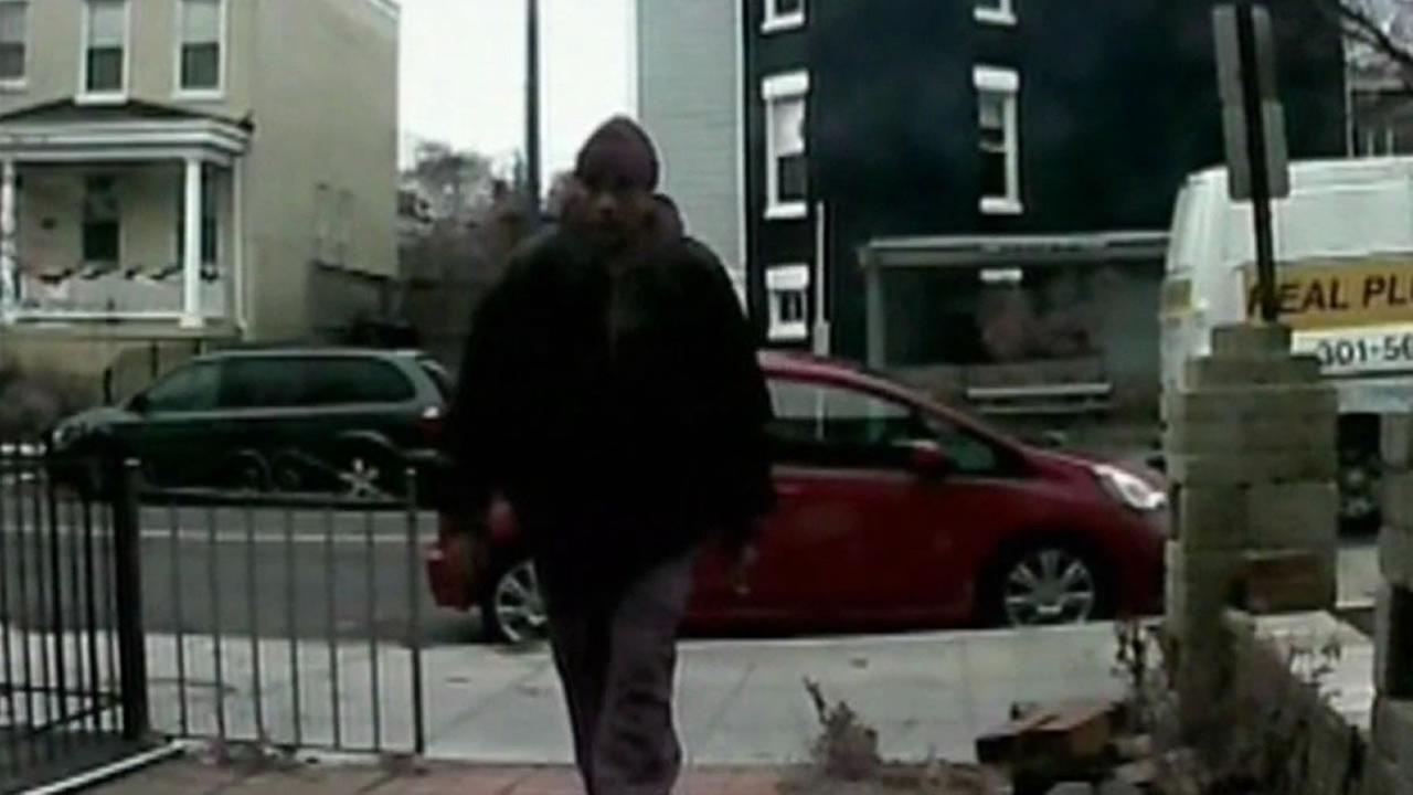 Surveillance camera photo of package thief