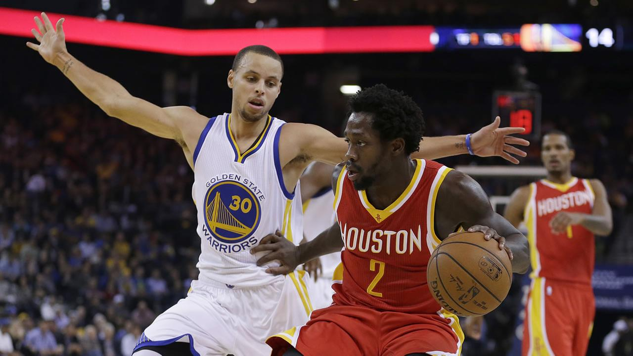 Houston Rockets Patrick Beverley (2) drives the ball against Golden State Warriors Stephen Curry, left, during the first half of an NBA basketball game Wednesday, Dec. 10, 2014,