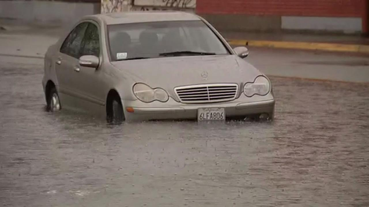 A Mercedes Benz stuck in flood water in Oakland on Thursday, Dec. 11, 2014 (ABC7 News)