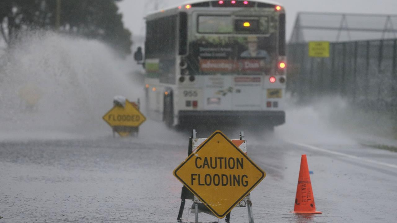 A bus passes through a flooded roadway Thursday, Dec. 11, 2014, in Mill Valley, Calif. (AP)