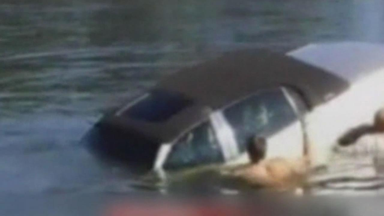 An elderly man was rescued after his car drove into a lake, knocking him unconscious.