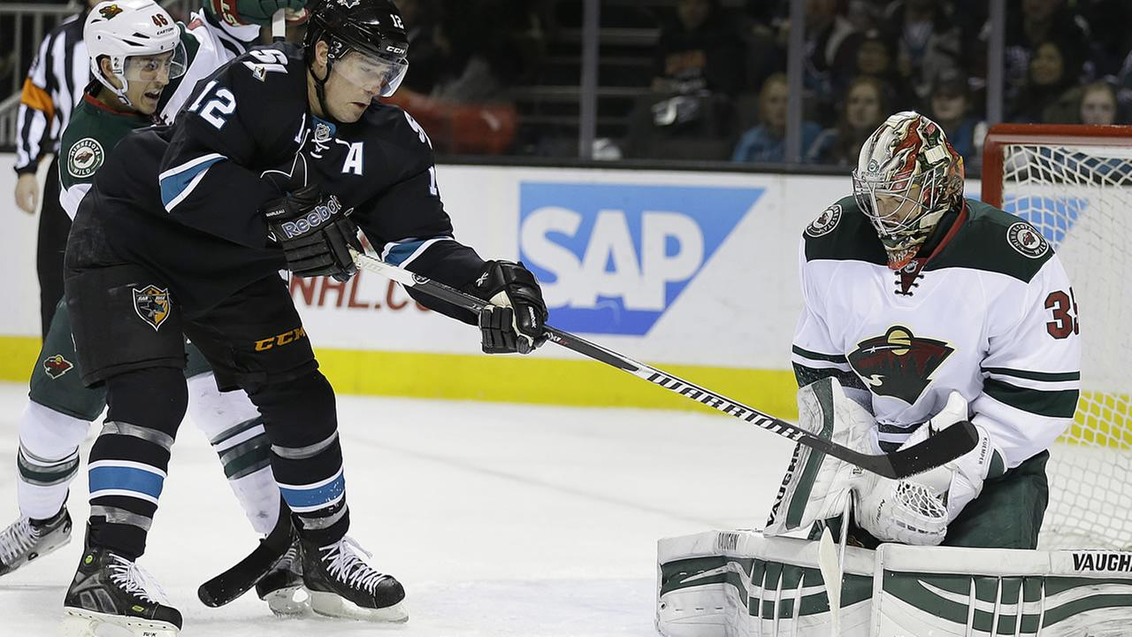 San Jose Sharks Patrick Marleau (12) takes a shot against Minnesota Wild goalie Darcy Kuemper, right, during the first period of an NHL hockey game Thursday, Dec. 11, 2014.