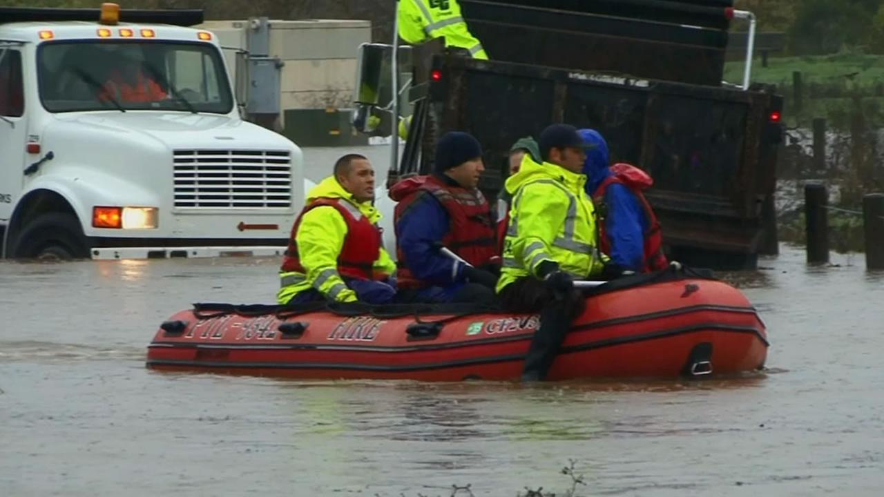 Petaluma firefighters used inflatable rafts to rescue 10 people trapped by rising flood waters in Thursdays storm.