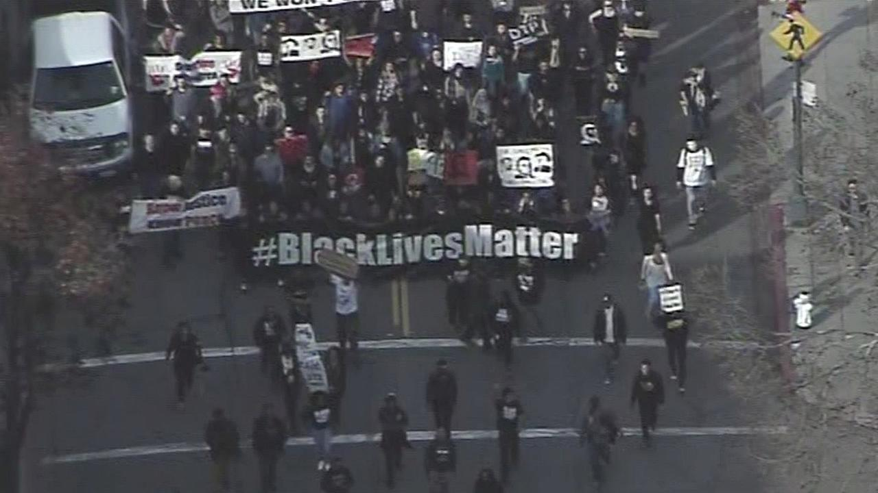 Protesters marching against police brutality on Market Street in San Francisco