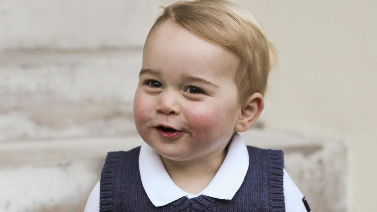 Britains Prince George poses for a photograph in a courtyard at Kensington Palace, London. (AP Photo/TRH The Duke and Duchess of Cambridge)
