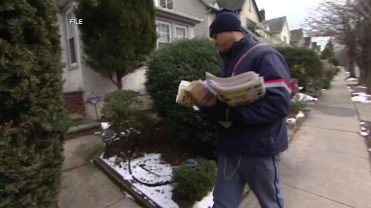 Mailman with the U.S. Postal Service delivers letters and packages.