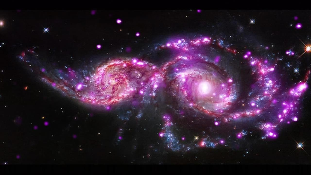 Image released by NASA shows two galaxies colliding.