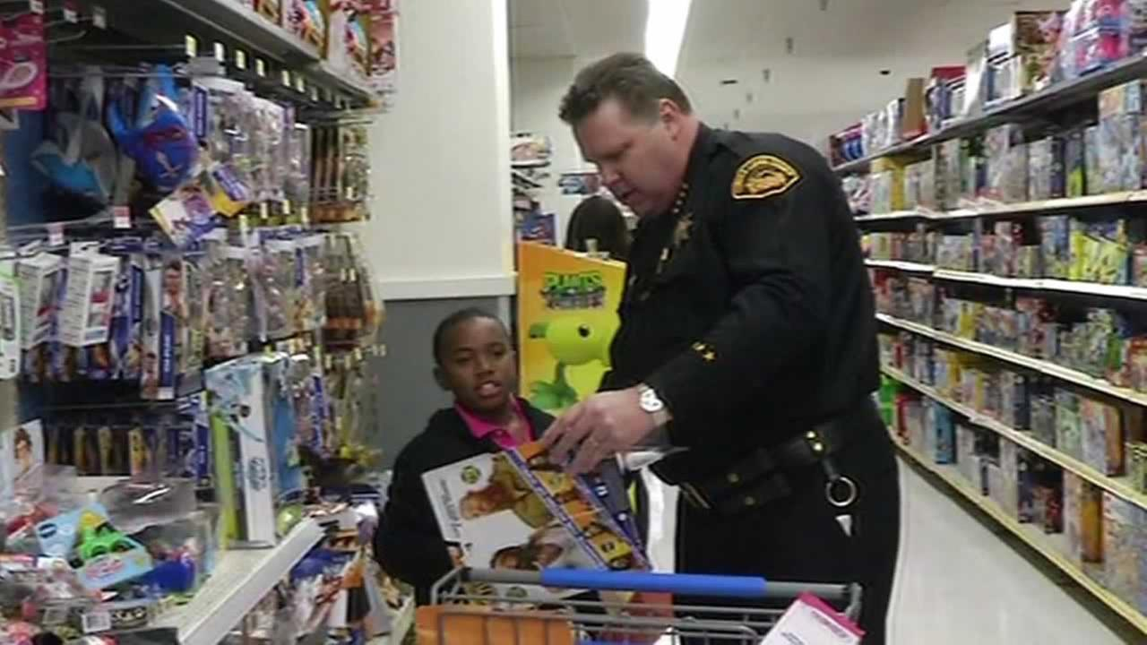 Deputies from the Contra Costa Sheriffs Department walked the aisles of the Richmond Walmart store, helping kids from low-income families buy gifts for their families.
