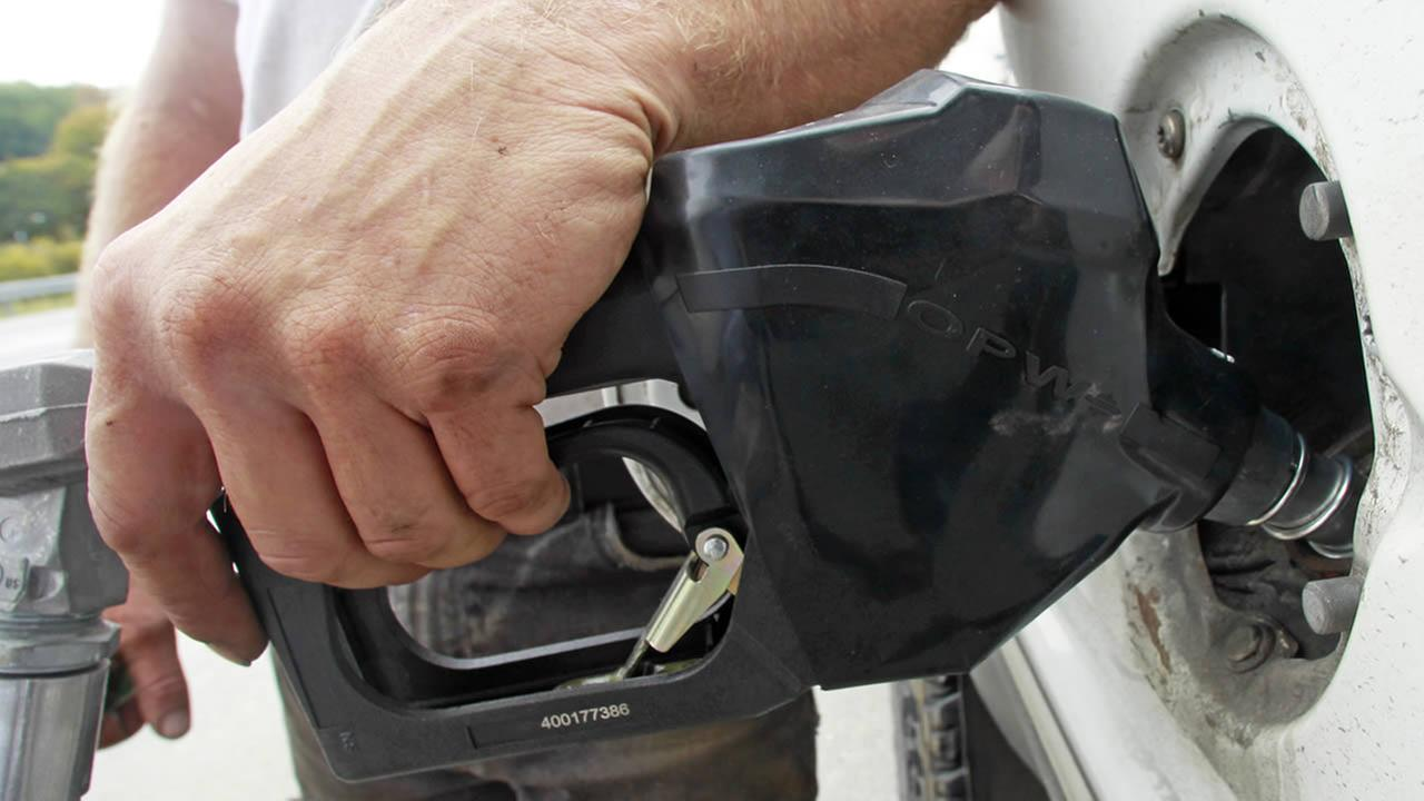 A customer fills up at a gas pump on Friday, Sept. 27, 2013 in Montpelier, Vt. (AP Photo/Toby Talbot)