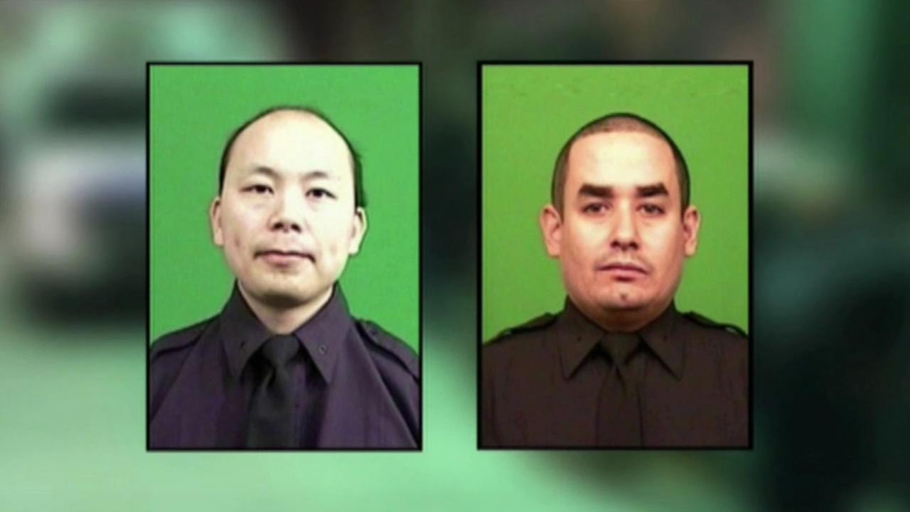 New York Police Department officers Raphael Ramos and Wenjian Liu were fatally shot on Saturday, Dec. 20, 2014.
