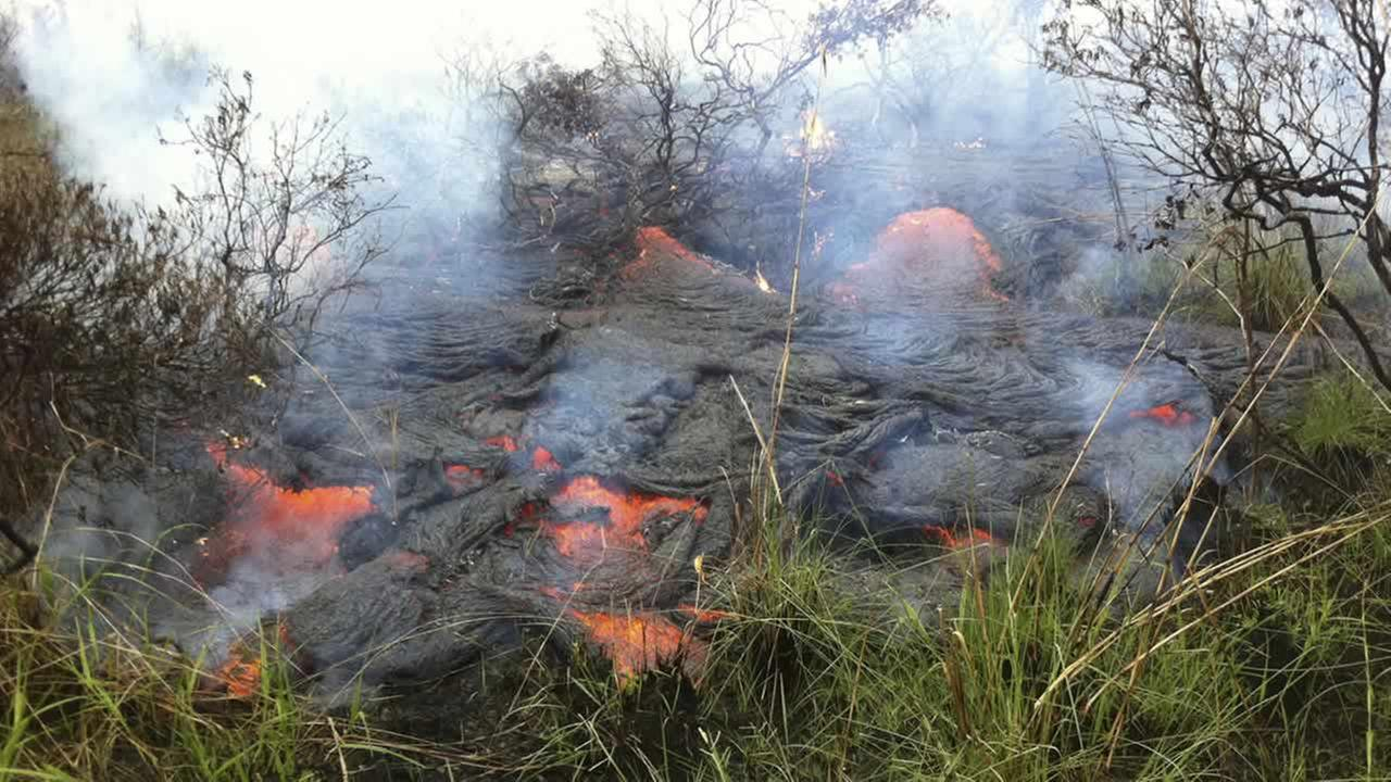 In this photo taken Dec. 12, 2014, the active lava flow front continues to advance downslope towards the northeast about a mile and a half from the marketplace in Pahoa, Hawaii. (AP Photo/U.S. Geological Suvery, Tim Orr)