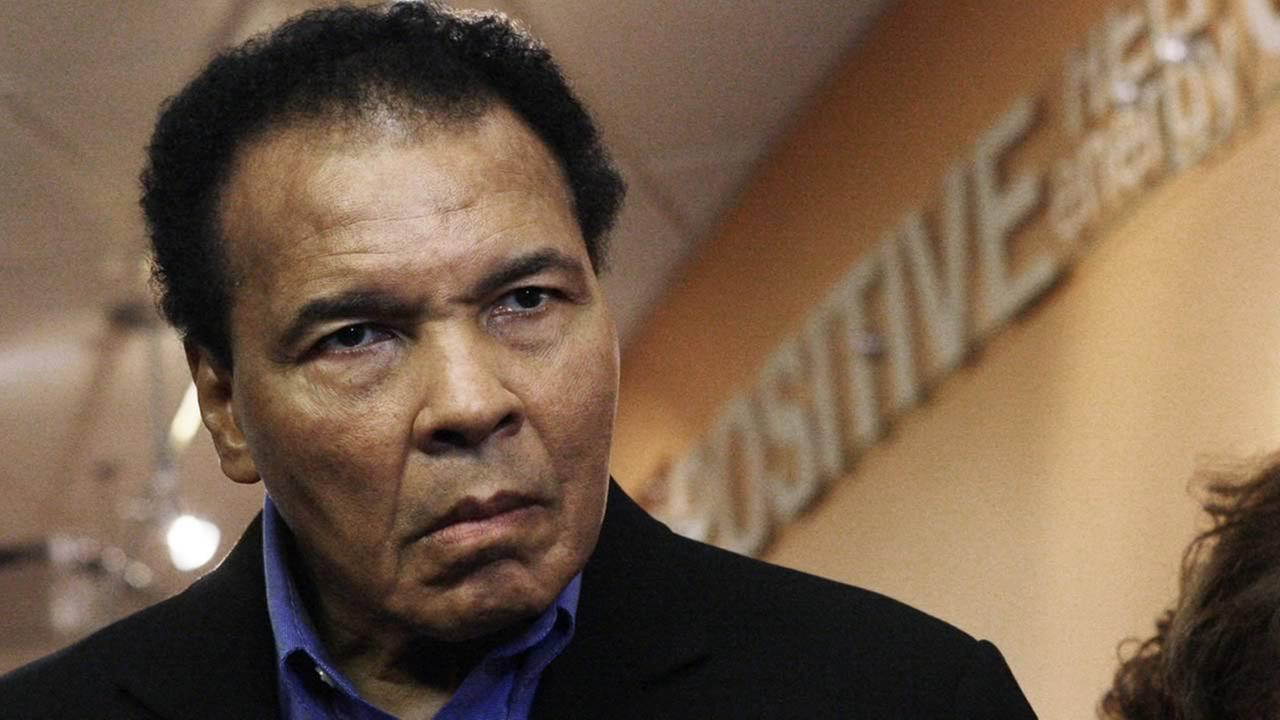 In this Dec. 3, 2009 file photo, former heavyweight boxing champion Muhammad Ali tours the new Muhammad Ali Parkinson Center at St. Josephs Hospital and Medical Center in Phoenix. (AP Photo/Ross D. Franklin, File)