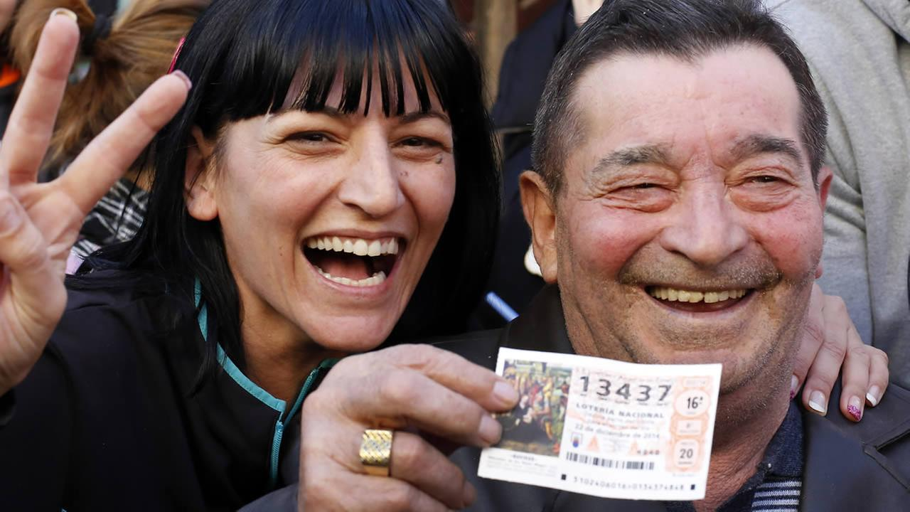 Winners of a Spain lottery celebrate the first Christmas lottery prize El Gordo (The Fat One) in La Eliana, near Valencia, eastern Spain, Spain, Dec. 22, 2014. (AP Photo)