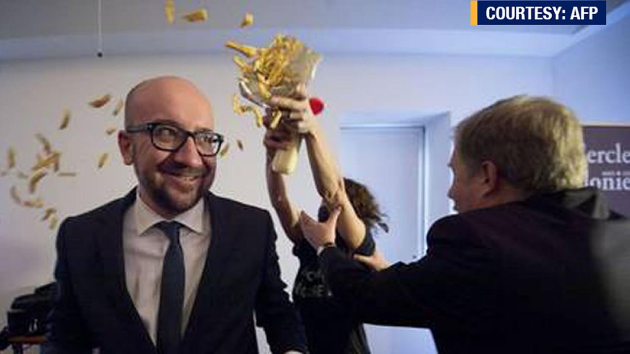 Belgiums prime minister Charles Michel was the victim of an unusual attack, protesters threw french fries and mayonnaise at him.
