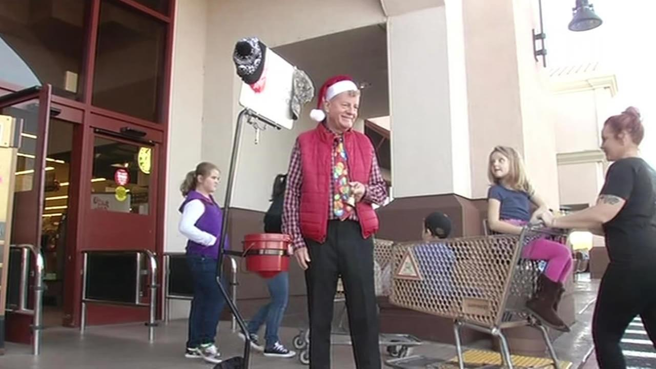 Salvation Army red kettle volunteer Michael Palmer stands outside a Safeway in Napa, Calif. on Dec. 23, 2014.
