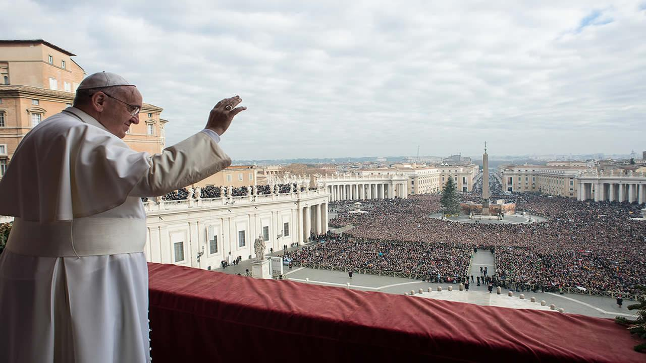 Pope Francis delivers his Urbi et Orbi (to the city and to the world) blessing from the central balcony of St. Peters Basilica at the Vatican, Thursday, Dec. 25, 2014. (AP)