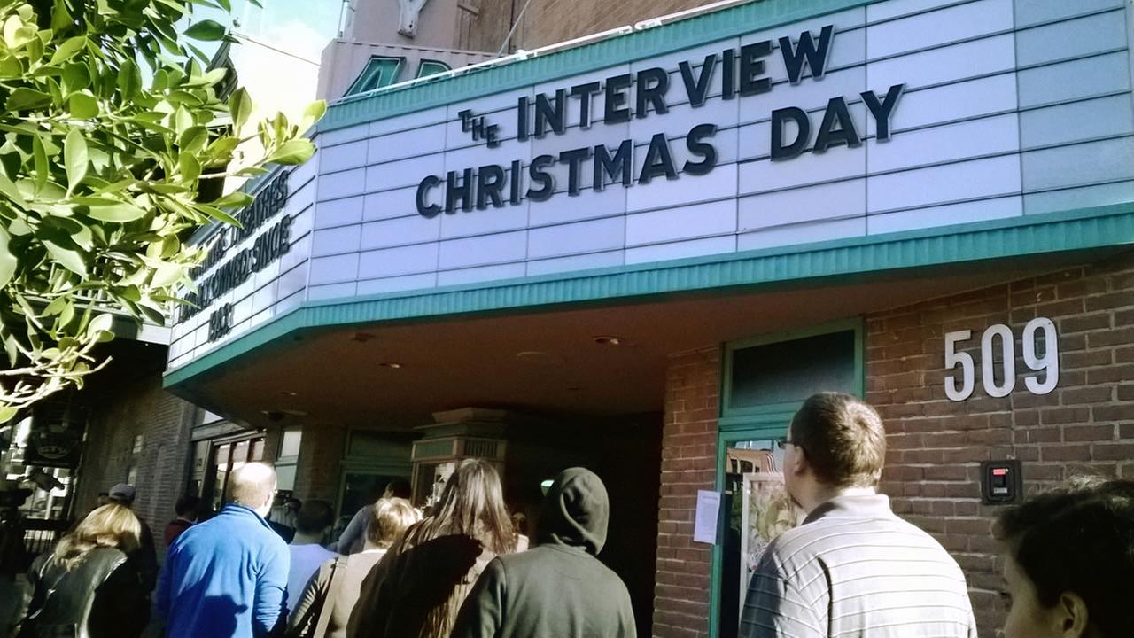 People waiting in line for movie