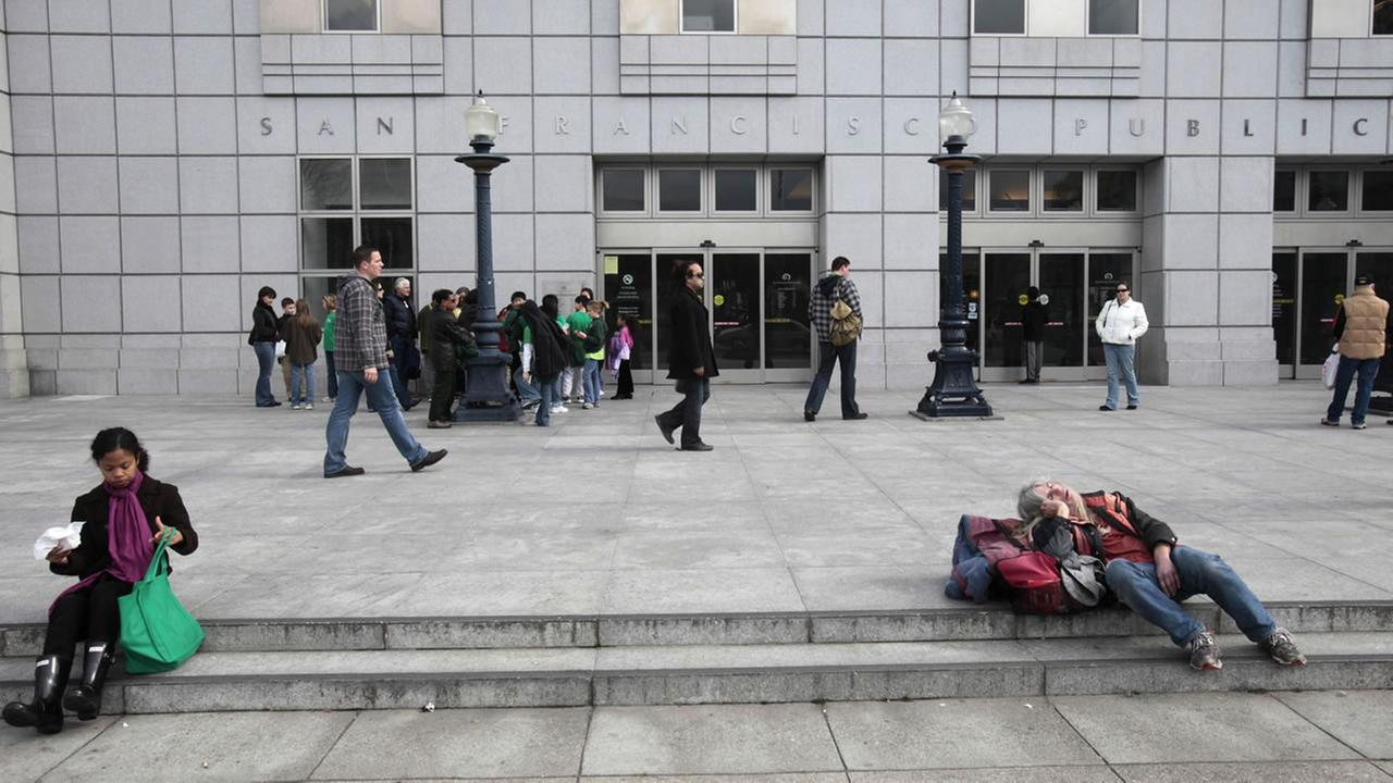 homeless in front of the San Francisco library