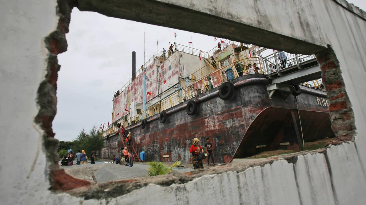 The devastating tsunami struck a dozen countries around the Indian Ocean, killing 230,000 people, most of them in Aceh. The power plant is now a major tourist attraction (AP).