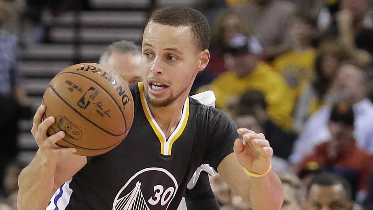 Golden State Warriors guard Stephen Curry (30) controls the ball over Minnesota Timberwolves center Gorgui Dieng during the third quarter.