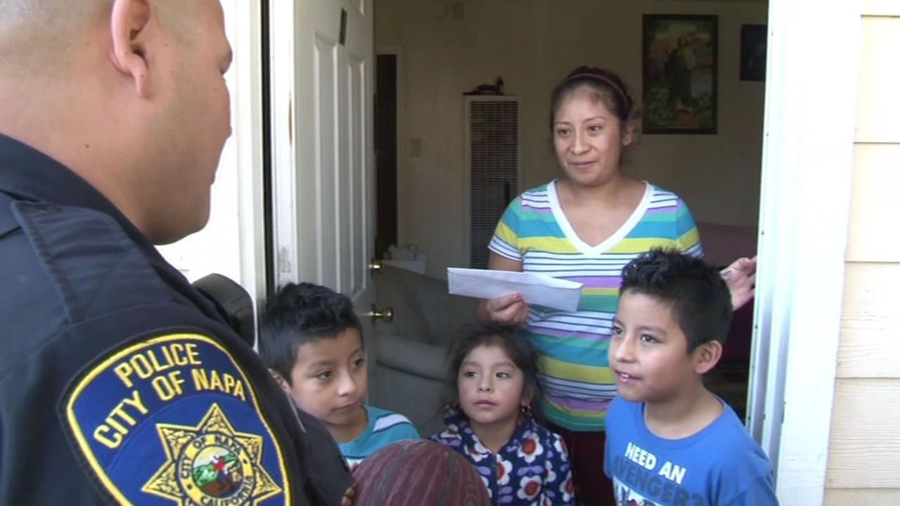 police hand money to family
