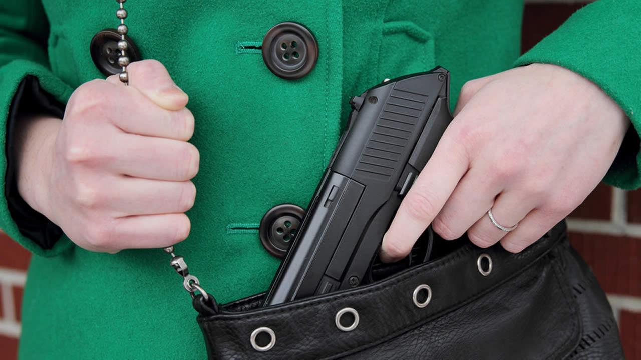 A woman with a concealed weapon.