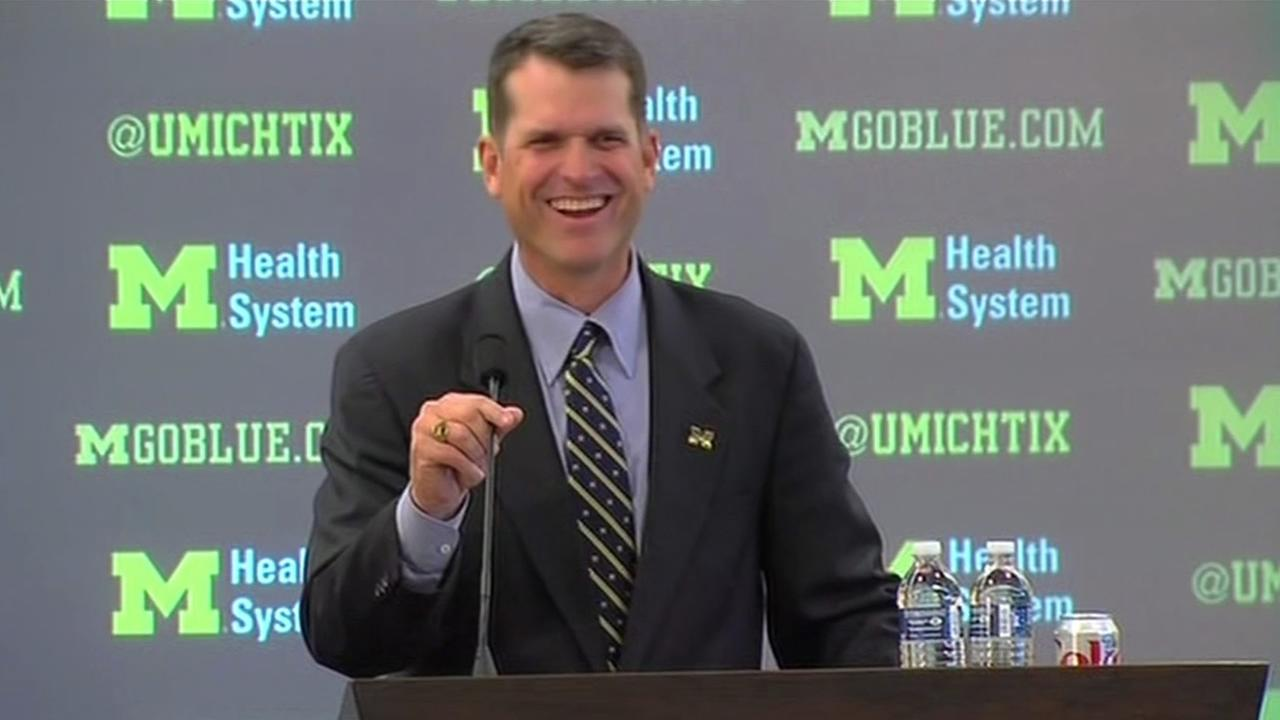 Former San Francisco 49ers coach Jim Harbaugh was all smiles as he was officially welcomed as the new head coach at Michigan on Tuesday, Dec. 30, 2014.