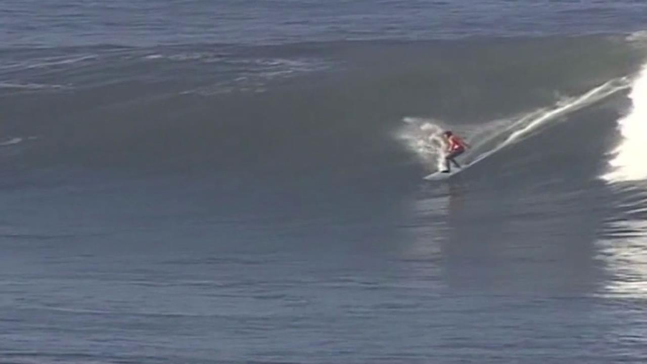 surfer riding a wave at Mavericks Surf Contest
