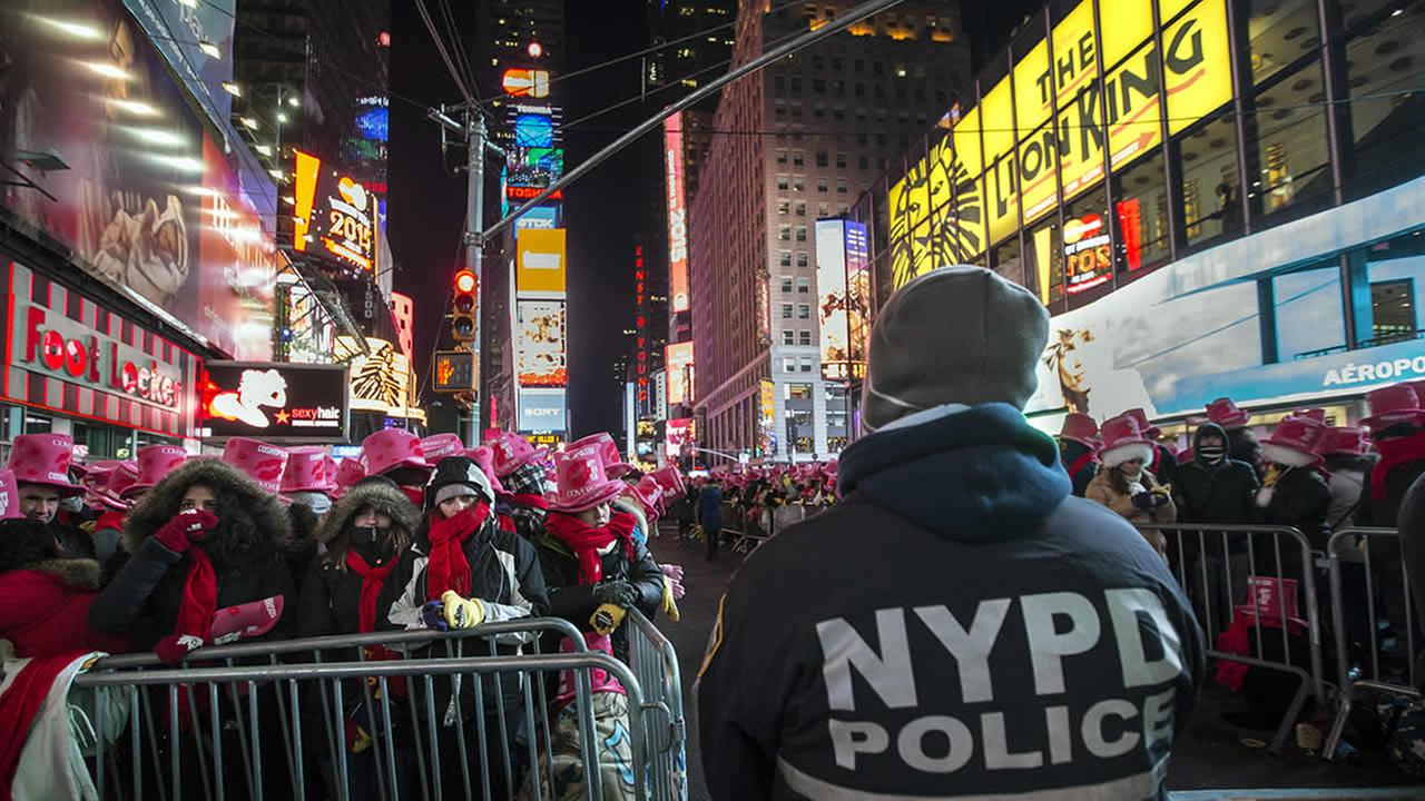 New York Police Department officers stand guard in Times SquareAP Photo/John Minchillo