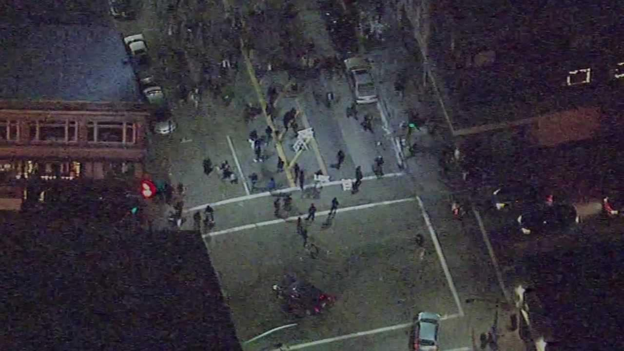 Sky7 HD was over the crowd protesting against police brutality at 14th and Broadway in Oakland on New Years Eve .